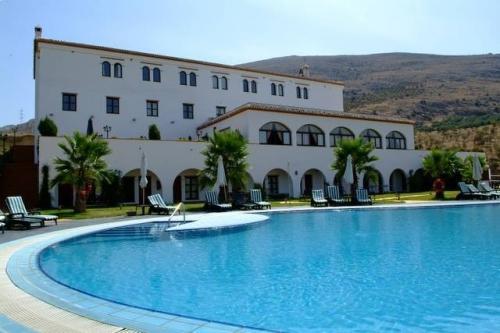 Hotel almazara hotel rural en riofrio granada for Jr piscina granada