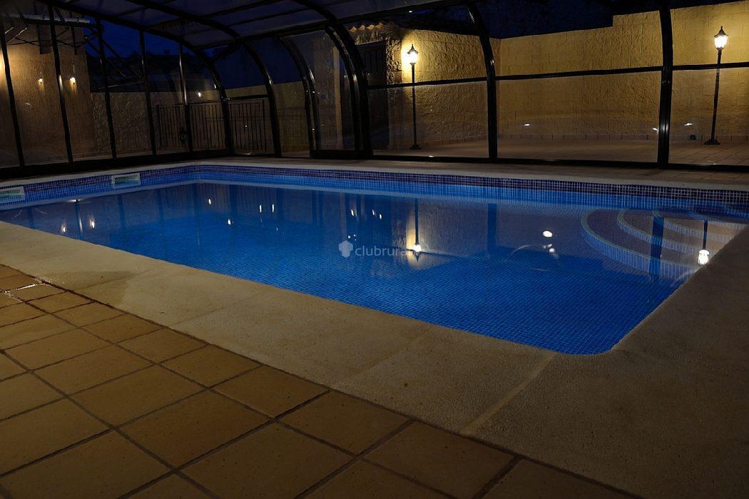 Fotos de la casa de las parrillas cuenca ribagorda for Casa rural piscina climatizada interior